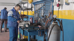 Engine on the desk - auto mechanic repairs  a motor of a car - dolly Stock Footage