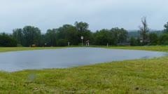 Flooded field in rain Stock Footage