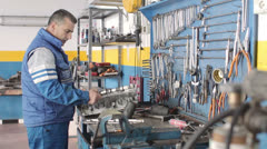 the work of Auto mechanic -  Auto mechanic  repairing a motor - dolly - stock footage