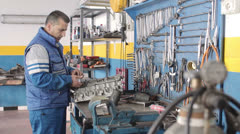 the work of Auto mechanic -  Auto mechanic  repair - dolly - stock footage