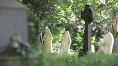 Celtic Cross gravestone in an English church yard Stock Footage