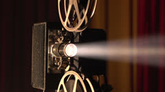 Film projector dolly shot, then white out Stock Footage