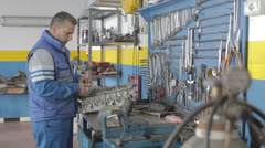Car repair - auto mechanic - dolly Stock Footage