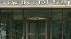 F.B.I. building entrance and sign Stock Footage