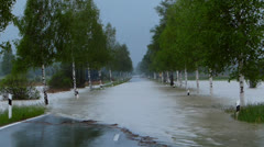 Flooded road in rain Stock Footage