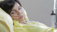 sleepy and sad woman in a bed of the hospital for lung cancer - stock footage