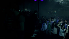 Overview of a nightclub full of guys dancing and having fun - disco Stock Footage
