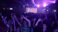 Guys move to the beat of music in a crowded disco -discotheque - nightclub Stock Footage