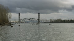 Vertical lift bridge over river Stock Footage