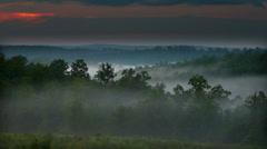 Rolling hils (Missouri Ozarks) with mist / fog Stock Footage