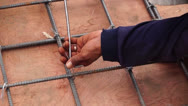 Steel Knot Tying Stock Footage