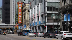 Stock Video Footage of Famous Chicago Theater, Theatre Sign, State Street, Traffic Jam, People Walking