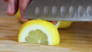 Stock Video Footage of Slicing Lemons