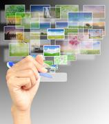 Young woman pointing multimedia screen with a pen Stock Photos