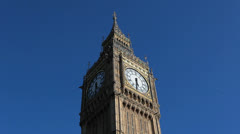 Big Ben clock tower against blue sky. Sunny day - London, UK 4 Stock Footage