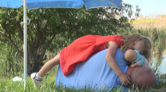 Close up of a Sleeping Child on his Father at a Fishing Lake, Resting Family Stock Footage