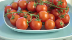 Red tomatoes in a plate rotate Stock Footage