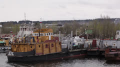 Old repair and freight ships at berth Stock Footage