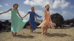 Hawaii -beautiful women in flowing dresses on beach - stock footage