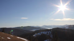 Mountains in winter with sun Stock Footage