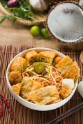 curry noodle malaysian penang style with raw ingredients on background - stock photo
