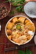 asam laksa noodle ,penang style with raw ingredients on background - stock photo