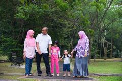 Malay family enjoying quality time outdoor at the park Stock Photos