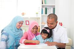 malay family learning together with lifestyle background - stock photo