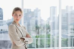 Stock Photo of Blonde businesswoman standing with arms crossed
