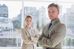 Stock Photo of Business people standing together with arms crossed