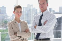 Serious business people with arms crossed - stock photo