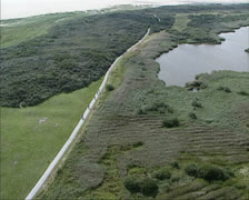 Aerial shot bike path at Schiermonnikoog, Wadden Sea Stock Footage