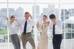 Group of business people raising arms as a success Stock Photos