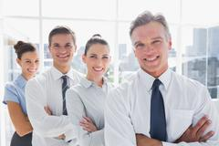 Stock Photo of Smiling business people standing together in line