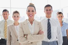 Stock Photo of Group of smiling business team standing together