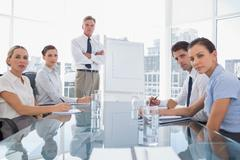 Stock Photo of Serious business people looking at camera during a meeting