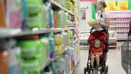 Stock Video Footage of Mother with her boy in baby carriage in the supermarket