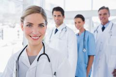 Stock Photo of Woman doctor in front of her colleagues