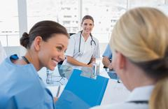 Doctors sitting in a meeting room Stock Photos