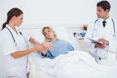 Doctor taking heartbeat of a patient Stock Photos