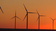 Stock Video Footage of Wind Turbines in Agriculture Field, Windmill on Cultivated Land, Sunset