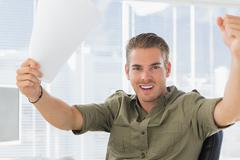 Creative business employee raising his arms Stock Photos