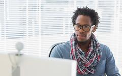 Creative business employee having a videocall - stock photo