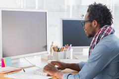 Stock Photo of Creative business worker on computer