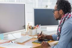 Graphic designer using a graphics tablet - stock photo