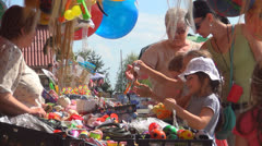 Children Buying Souvenirs for Parents from a Trip, Turists Looking for Gifts Stock Footage