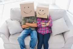 Funny employees wearing boxes on their heads Stock Photos
