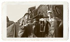 Vintage photo men and a train Stock Photos