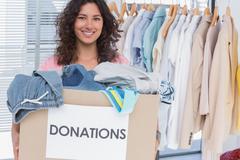 Stock Photo of Volunteer holding clothes donation box