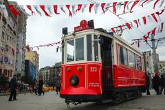 Old-fashioned red tram at the street of istanbul Stock Photos